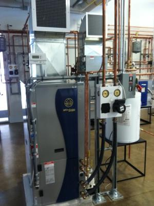 Geothermal water to air unit with pump pack mounted along side