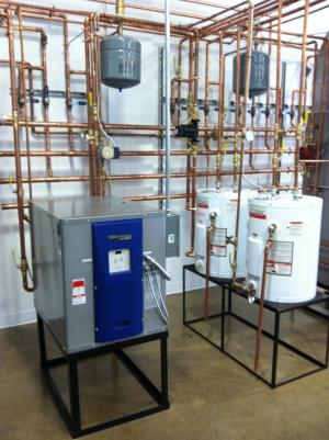 Geothermal water to air unit with 20 gallon storage tanks along side