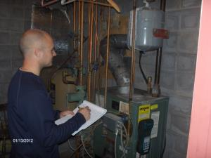 Checking boiler to make sure it complies with state & local codes